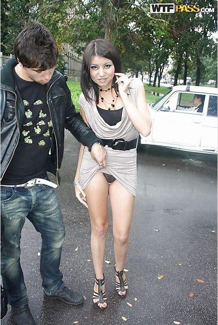 Pretty teen brunette babe on high heels doing upskirt outdoor - PornPics.com