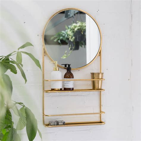 Circular Bathroom Mirrors by Gold Or Silver Circular Bathroom Mirror With Shelves By