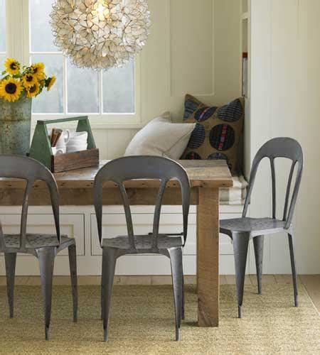farm table with metal chairs built in banquette transitional dining room