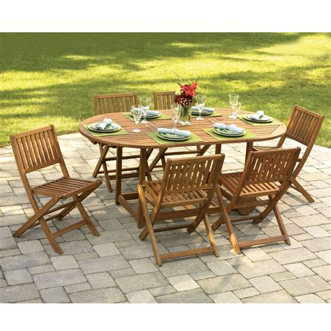 outdoor furniture table and chairs the gateleg patio table and stowable chairs hammacher