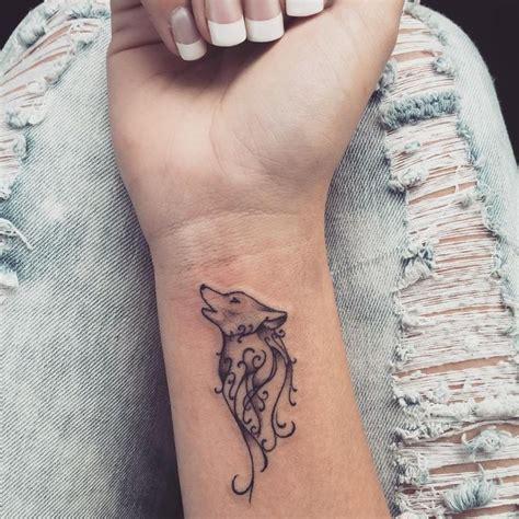 wolf wrist tattoo designs ideas  meaning tattoos
