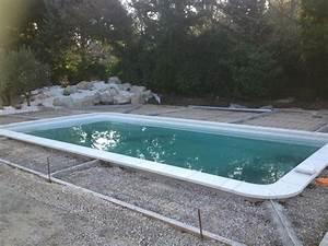 photos des piscines distribuees par aigo piscines a l With comment poser des dalles autour d une piscine