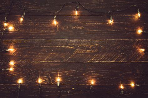 Christmas Lights Bulb On Wood Table. Merry Christmas (xmas