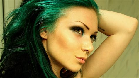 Green Haired Girl With A Pierced Nose And Tattoos On Arm
