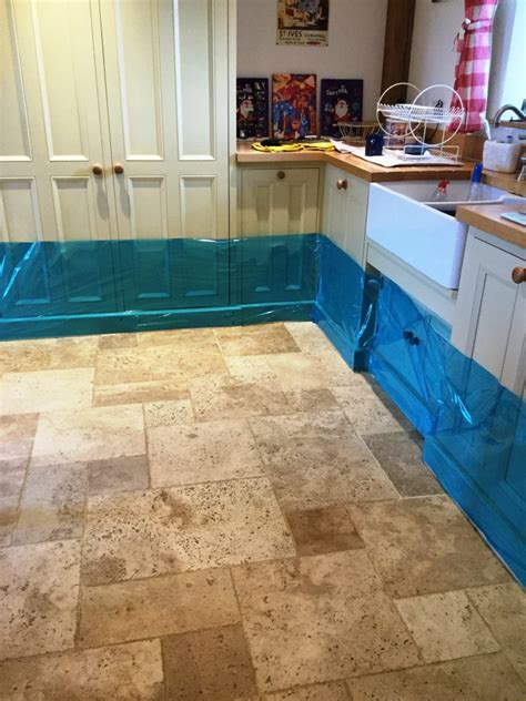 badly stained  pitted travertine tiled kitchen floor