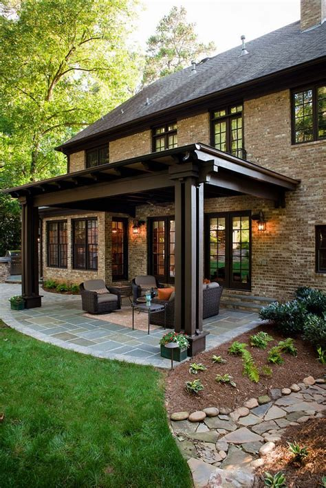 covered porch ideas this backyard is now in unison with the rest of this lovely home covered patios backyards