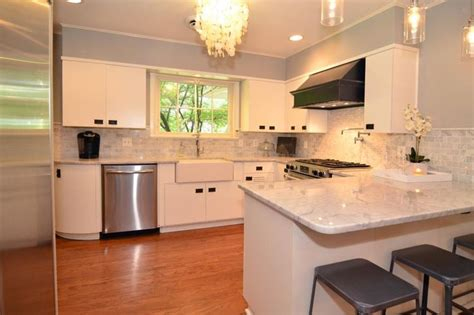 images of kitchens with white cabinets outfitted with gleaming marble countertops and a glitzy 8981