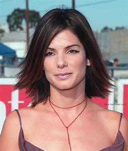 Sandra Bullock Youthful medium length hairstyle with highlights and a flip at the ends