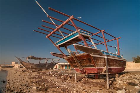 Fishing Boat Qatar by Photo 1174 14 Wooden Beached Dhow Fishing Boats In Al