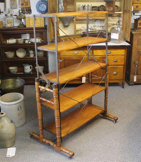 bargain johns antiques rare antique wooden  cast iron bakers rack  turns   table