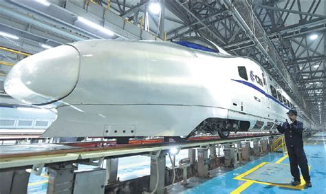 technician checks  crh train  chongqing xinhua