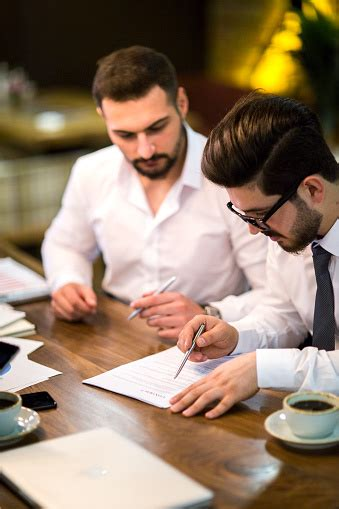 Business People Negotiating A Contract Stock Photo ...