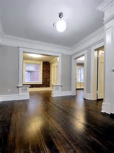 sw7641 collonade gray by sherwin williams this color against the white baseboards molding