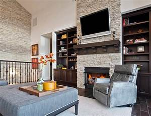 Stone accent wall living room transitional with living