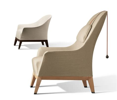 normal by giorgetti armchair wing chair with footrest