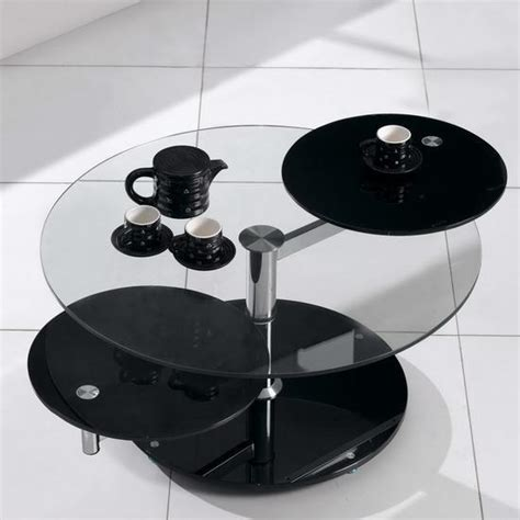 This ashley furniture murphy set comes with three. ROUND BLACK GLASS EXTENDING ROTATING COFFEE TABLE | eBay