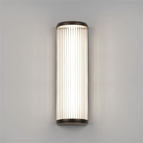 deco style bathroom wall light with glass rods and bronze