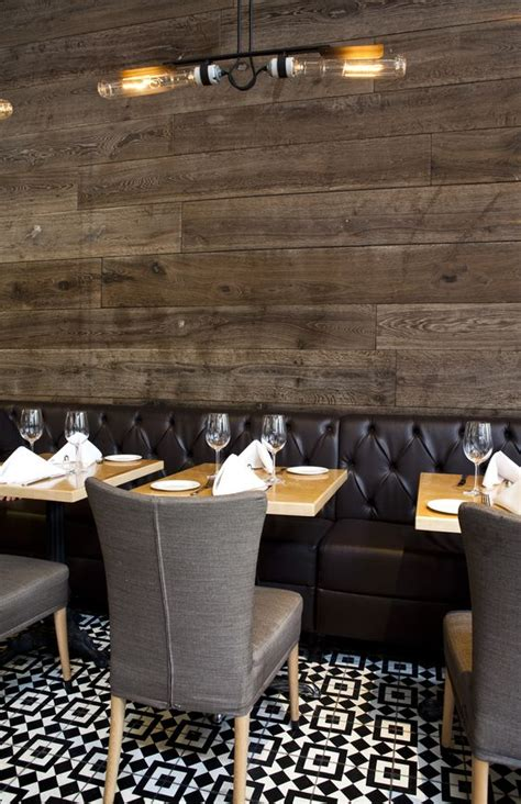 grey upholstered chairs with black banquette and