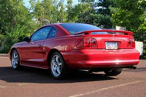 Daily Turismo: 10k: Future Gold: 1998 Ford Mustang SVT Cobra, low miles