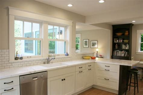 white cabinets with beige countertop beige transitional kitchen with white cabinetry hgtv