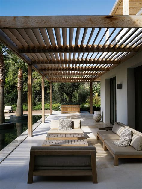 Thatched Roof House With Outdoor Entertaining Spaces by Modern Poolside Pergola A Concrete Patio With