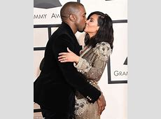 Kanye West can't keep his hands off Kim Kardashian at the