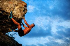 Free Climber Holding The Cliff Stock Image
