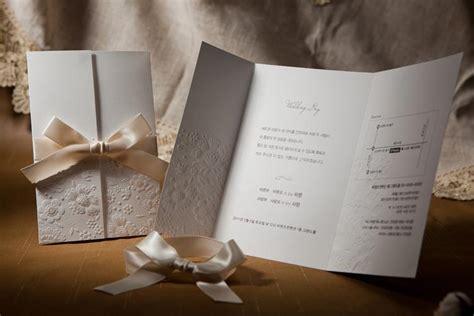 vintage embossed tri fold wedding invitation  ribbon