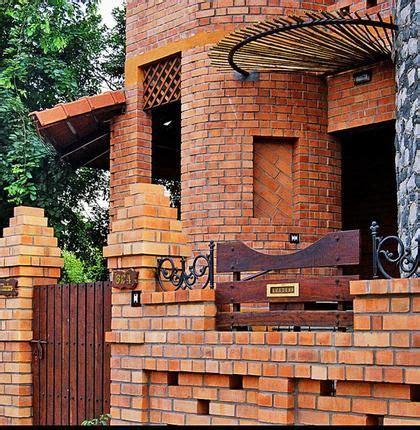 exposed brick facade  bengaluru farmhouse style exterior exterior wall design facade house