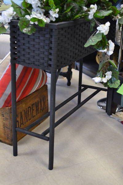 lovely black resin wicker rectangular plant stand