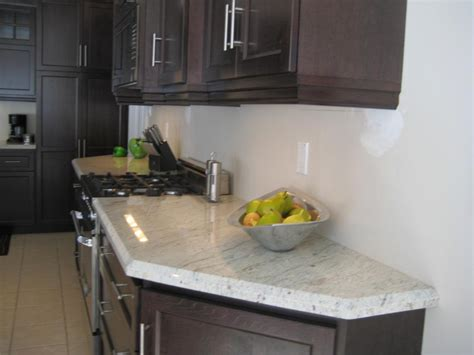 charming white granite countertops  elegant kitchen