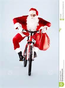 santa on bicycle stock photo image 16755280