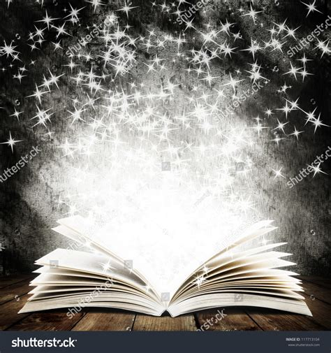 The Magic Of Wood And Light by Open Book Magic Light Falling Stock Photo 117713104