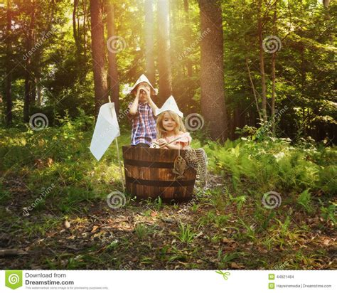 children fishing  wooden boat  forest stock photo