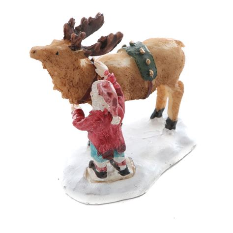miniature santa and reindeer christmas figurine