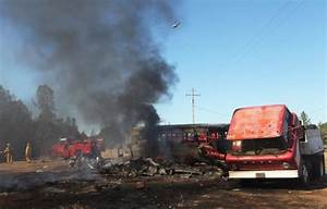 2-acre grass fire burns old bus