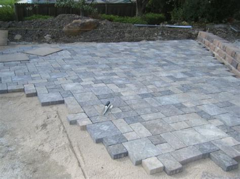 large tumbled paver patio retaining wall being installed