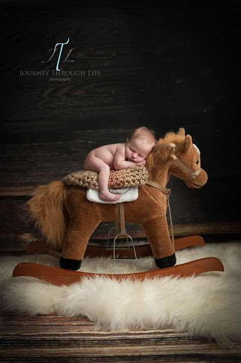 day  newborn baby boy cowboy  rocking horse