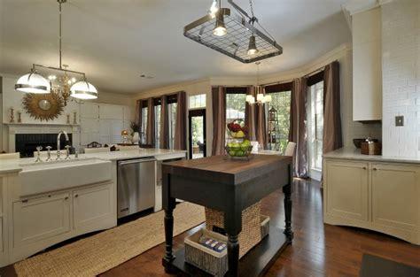 white kitchen with black island amber s white kitchen with black island 3 hooked on houses