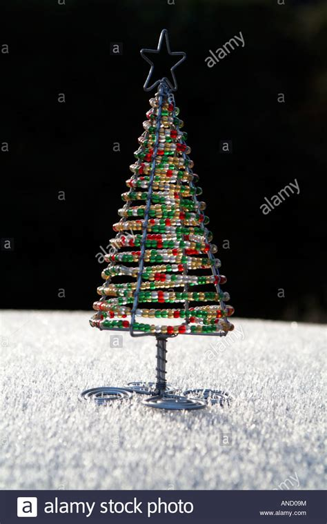 garden christmas tree decoration made with bent coat