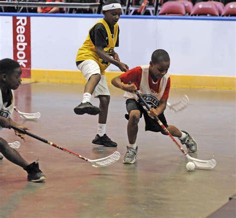 hit the floor running broward boys girls club youths hit the floor running in summer cats hockey play sun sentinel