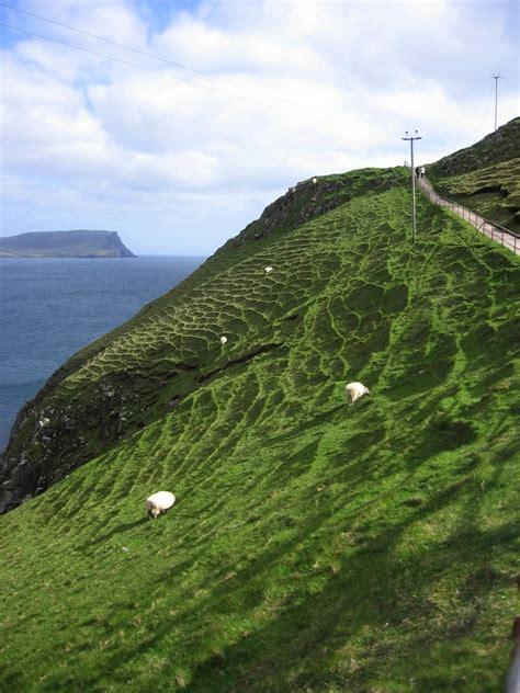 Walking To Neist Point Lighthouse On The Isle Of Skye