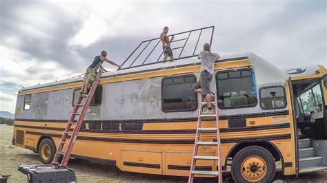 skoolie roof deck build begins removing school bus decals youtube