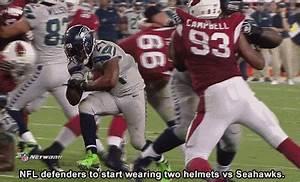 Marshawn Lynch Knocks Off Darnell Dockett's Helmet While ...