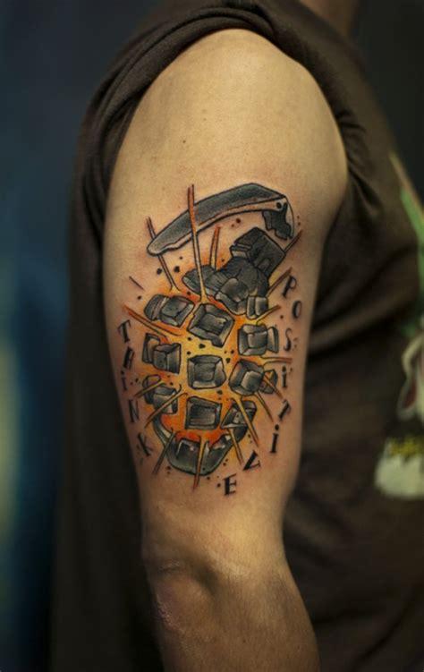 exploding grenade arm tattoo tattoomagz tattoo