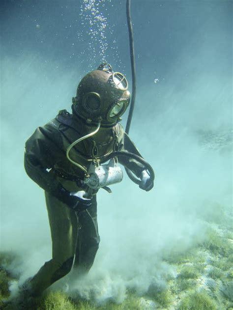 person  green scuba diving suit  stock photo