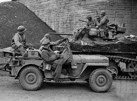 jeep tank military jeep with two wehrmacht officers as prisoner alongside a