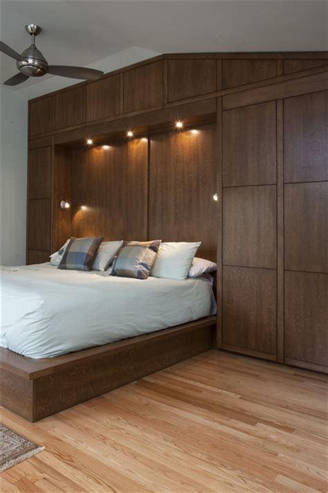 contemporary built in cabinets bedwall with built in cabinet surround hidden door