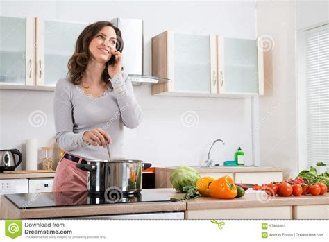 Talking Kitchen by With Mobile Phone While Cooking Stock Photo Image