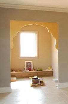 an puja room with marble floor and hanging bells